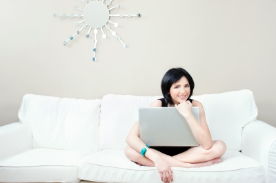 """Girl On White Sofa With Laptop"" by marin"