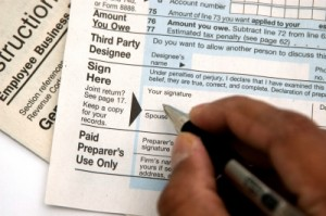 """""""Hand Signing A Tax Form"""" by Arvind Balaraman"""